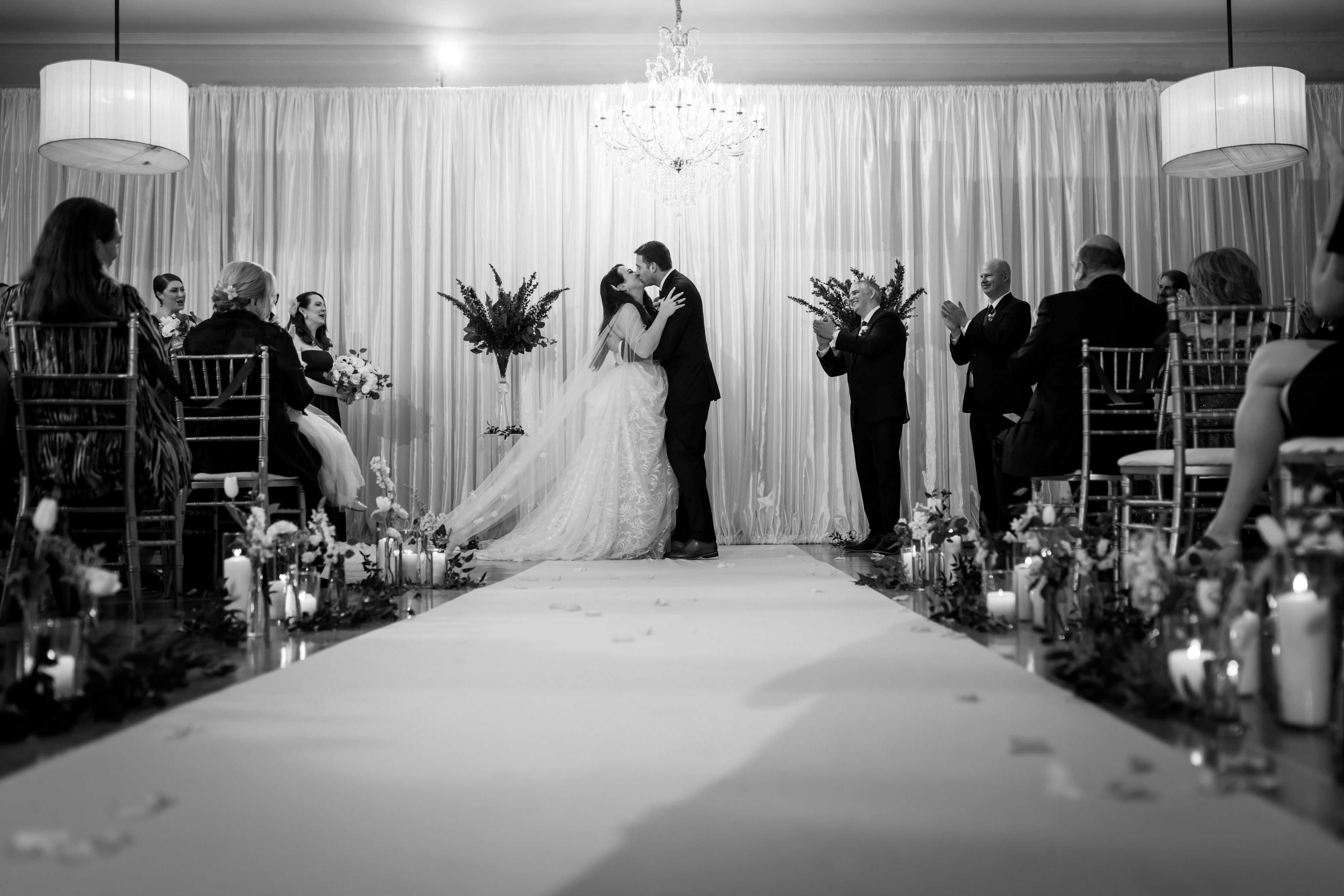 black and white photo of the kiss at the end of wedding ceremony at Stan Mansion