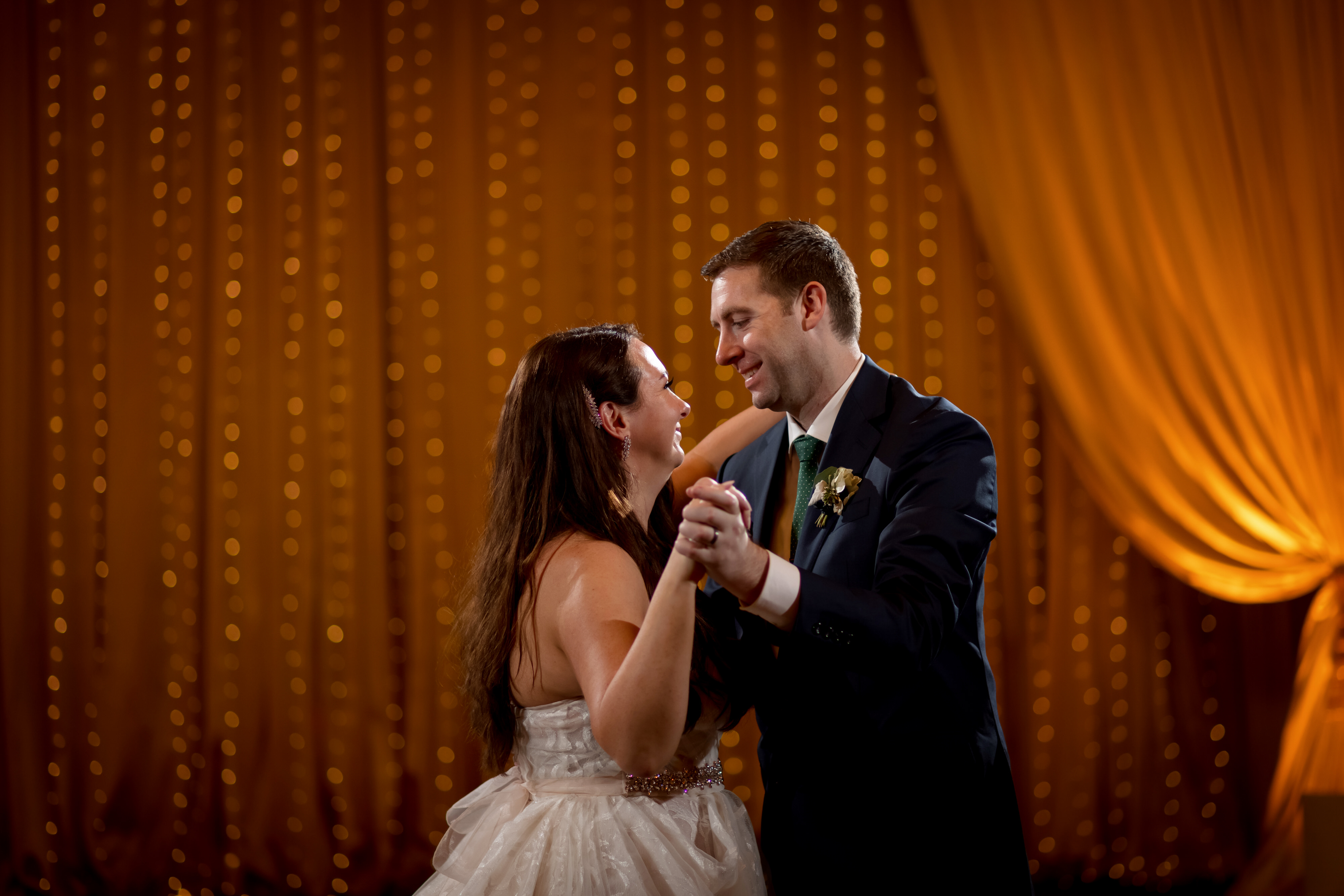 bride and groom first dance during wedding reception at Stan Mansion