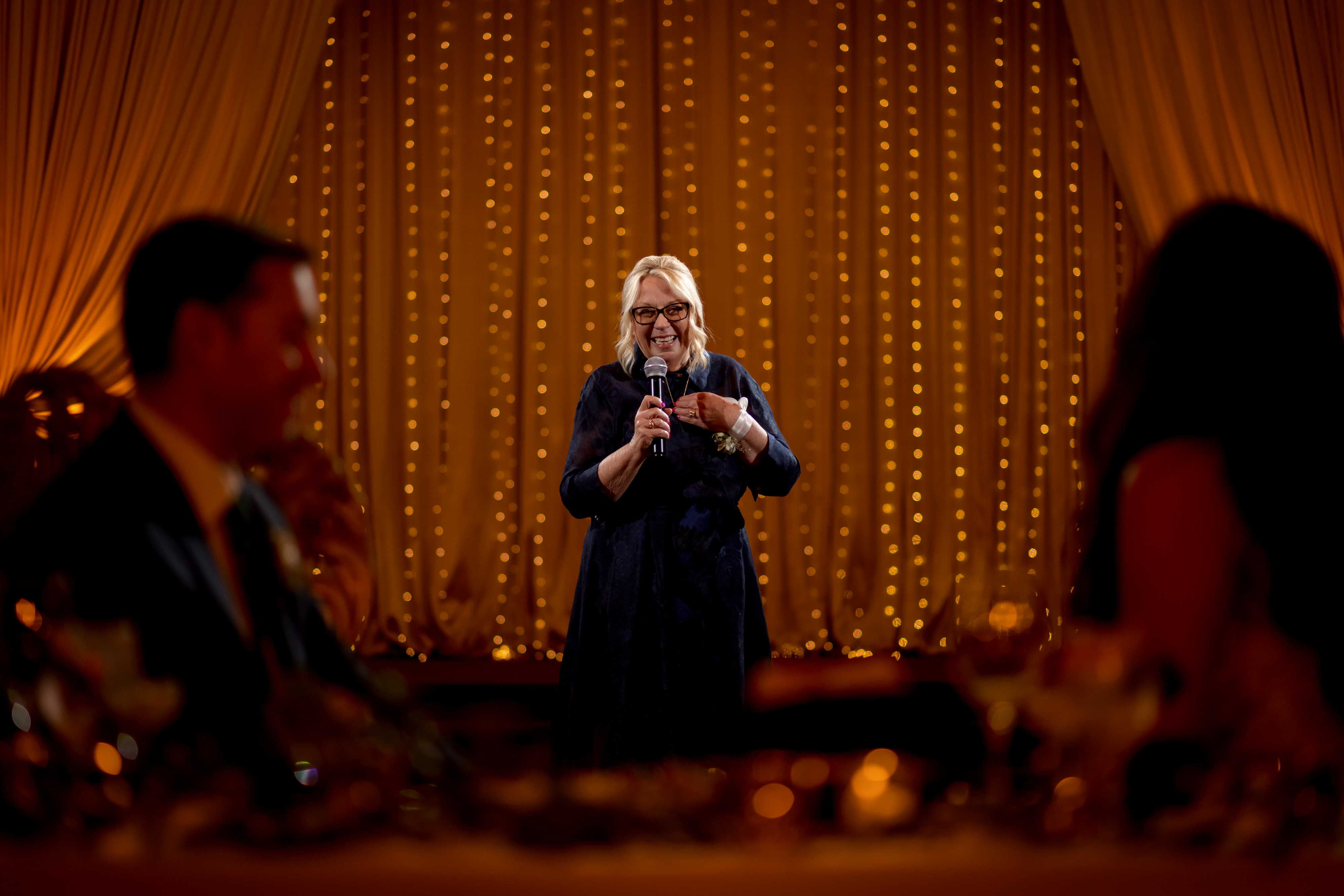 mother of the bride gives toast during wedding reception at Stan Mansion