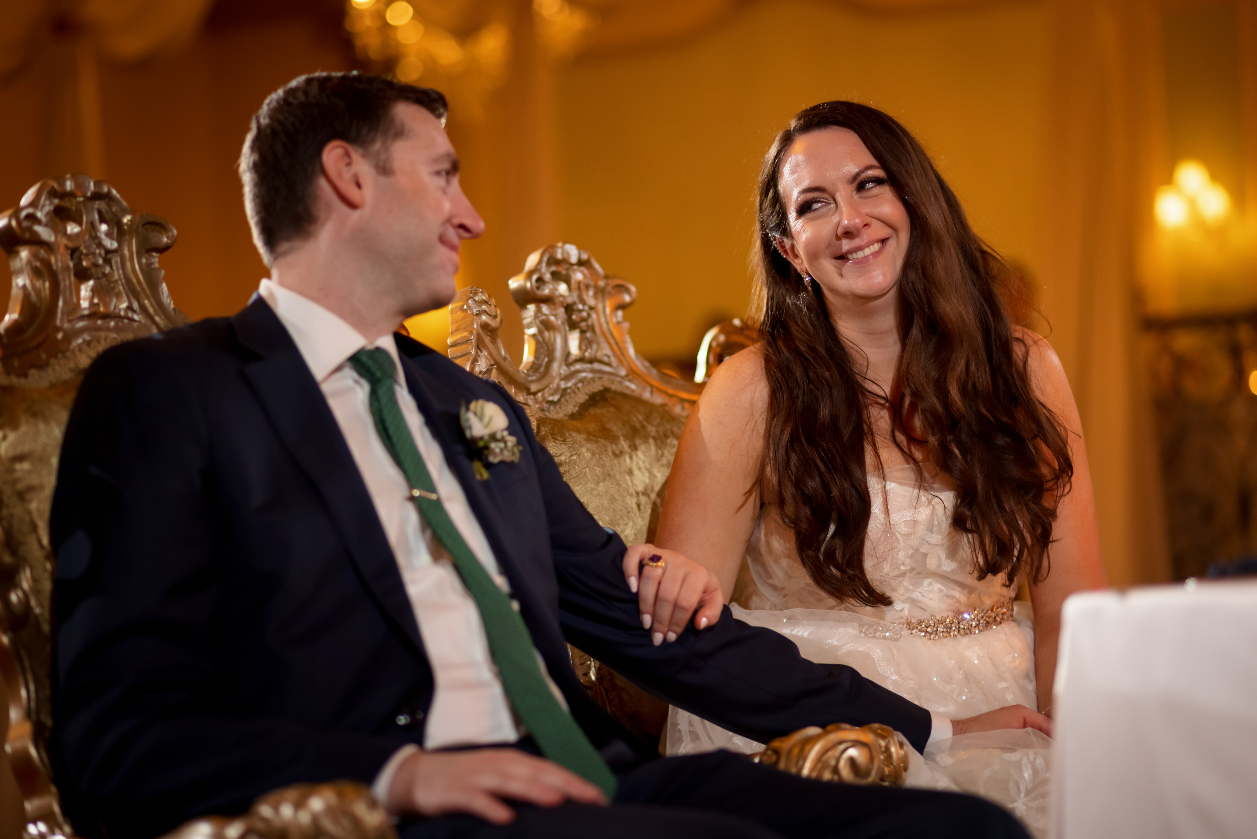 bride and groom react during toast at Stan Mansion wedding reception