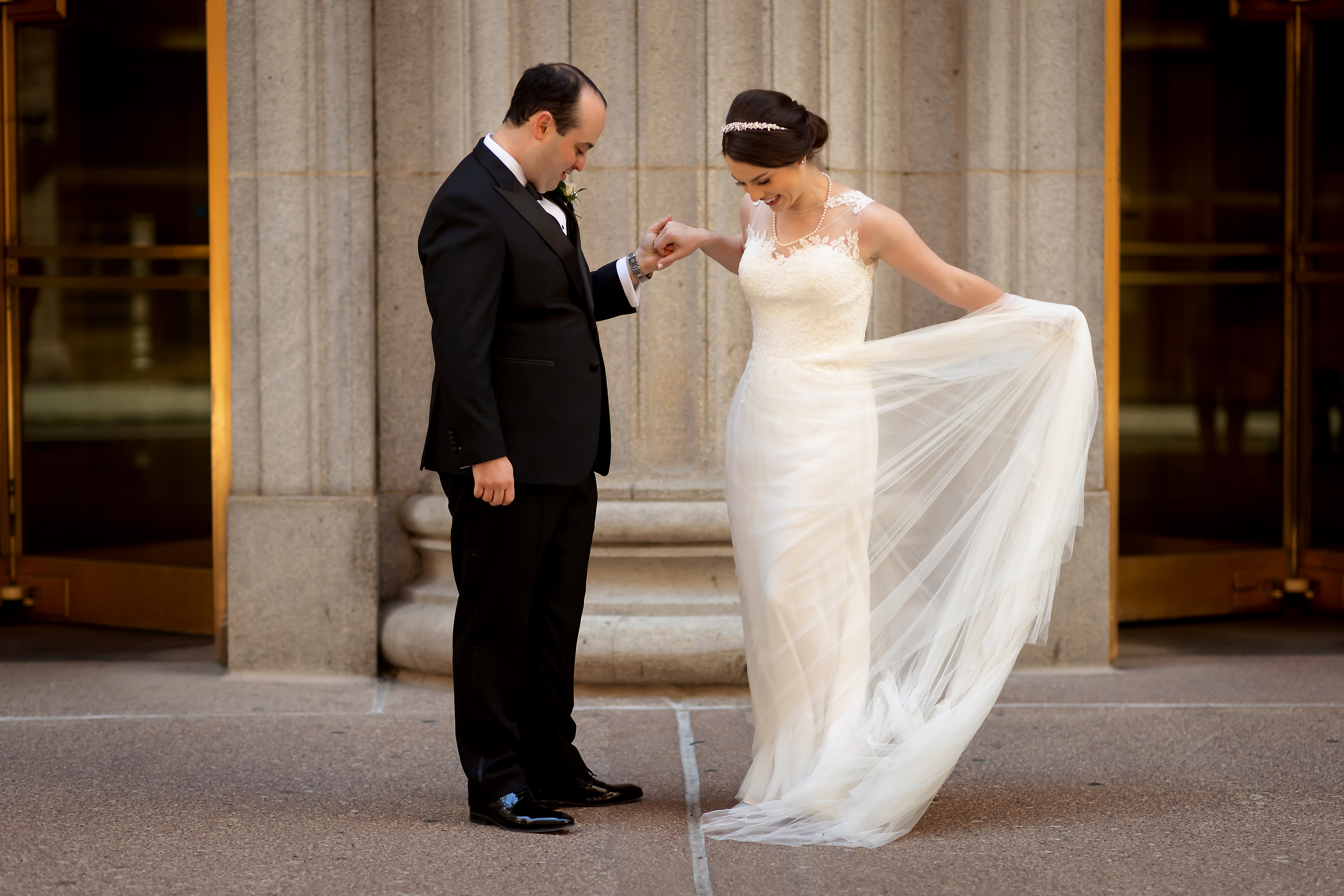 Groom reacts to seeing bride during first look on LaSalle Street in Chicago
