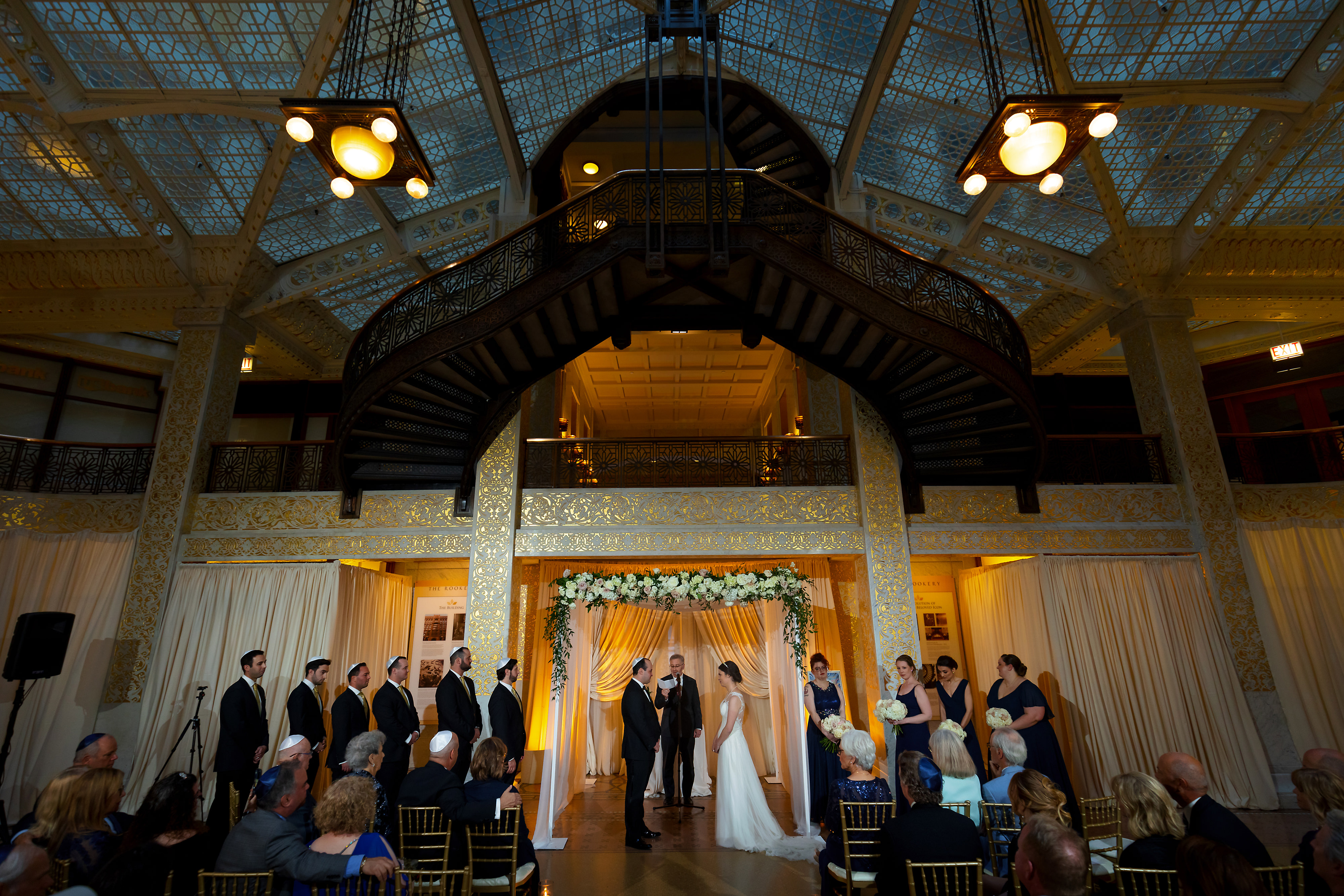 Wide angle shot of wedding ceremony the Rookery Building in downtown Chicago