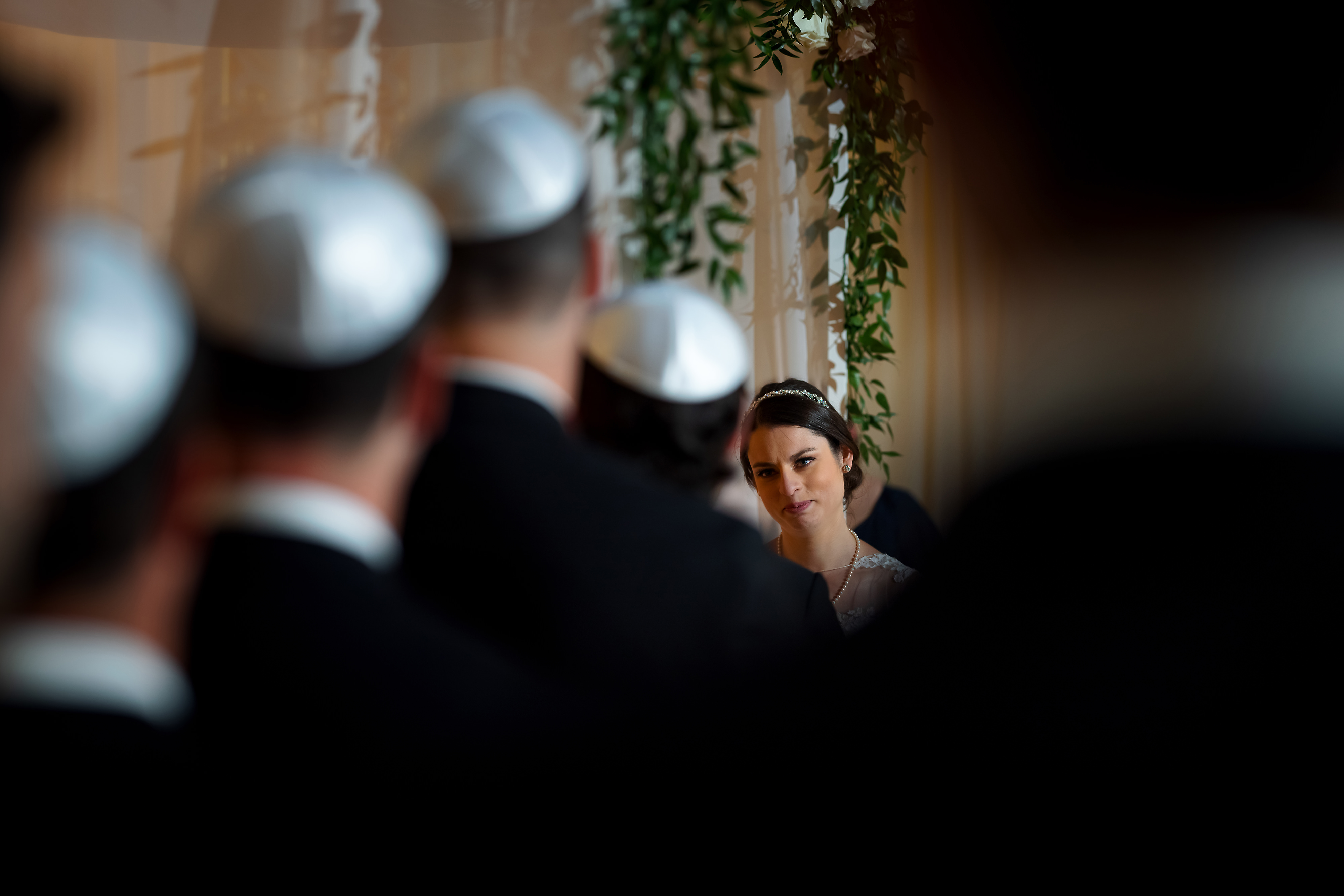 Bride looks at Groom during wedding ceremony at the Rookery Building in Chicago