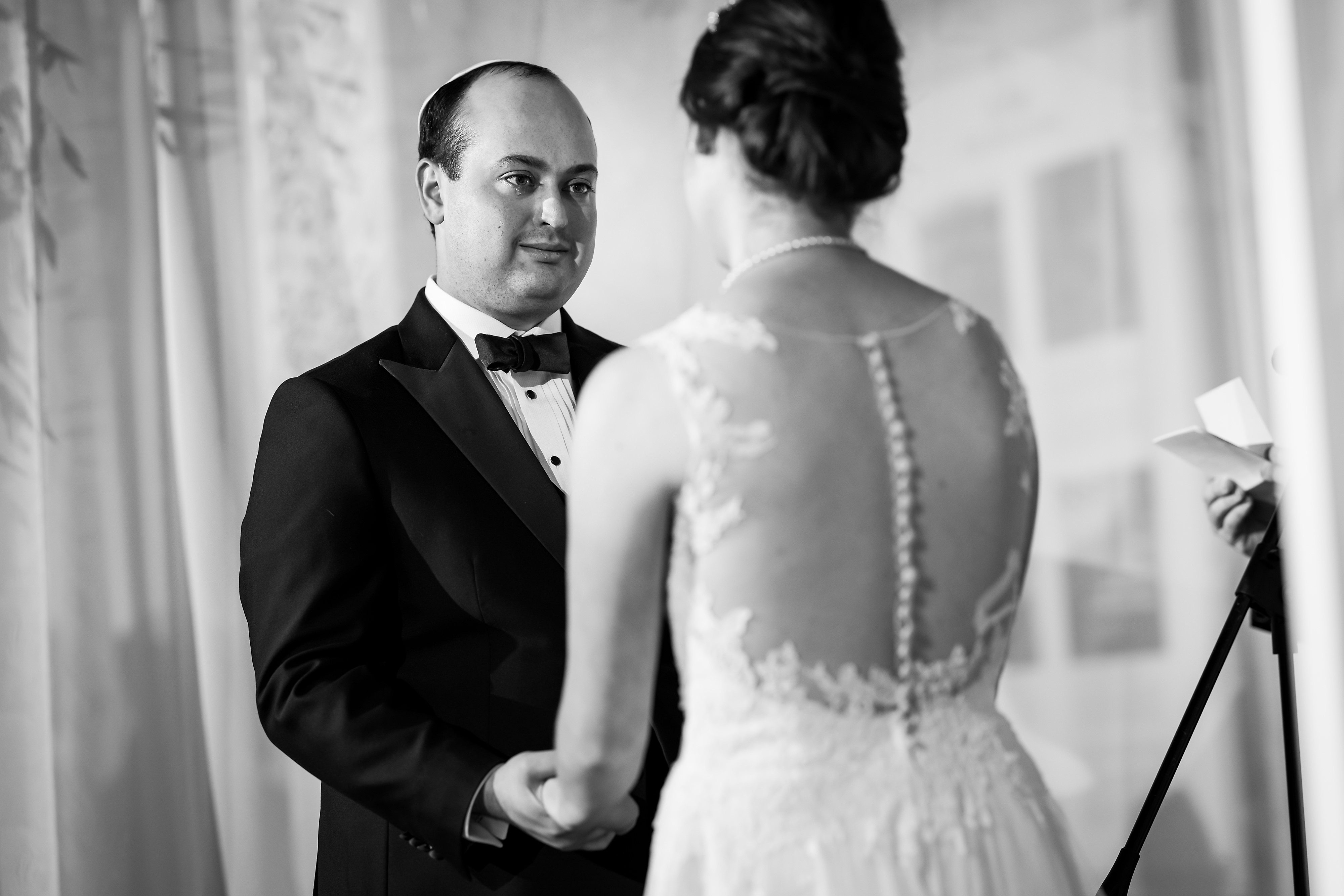 Groom is teary eyed during wedding ceremony at the Rookery Building in Chicago