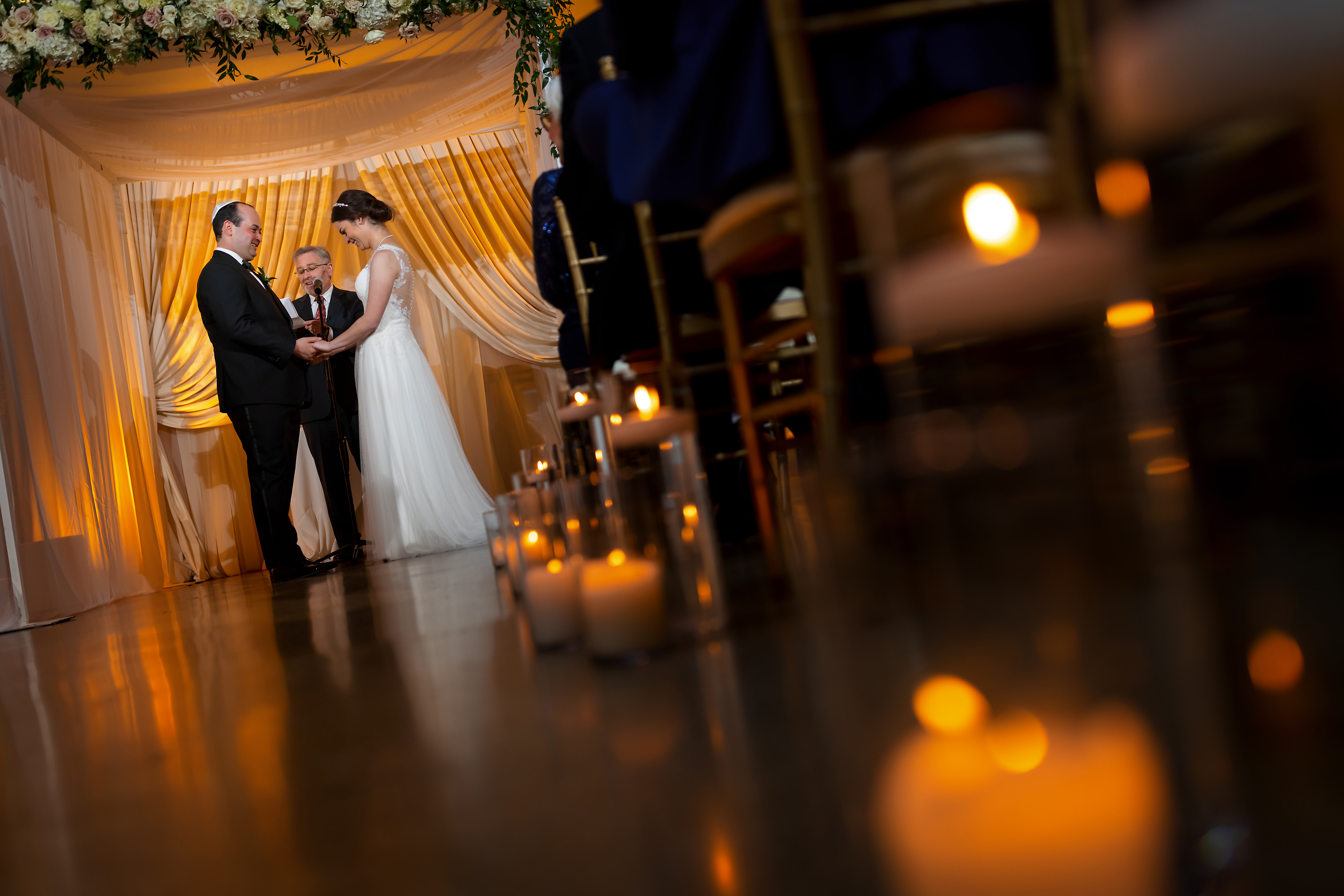 Bride and groom smile during wedding ceremony at the Rookery Building in Chicago