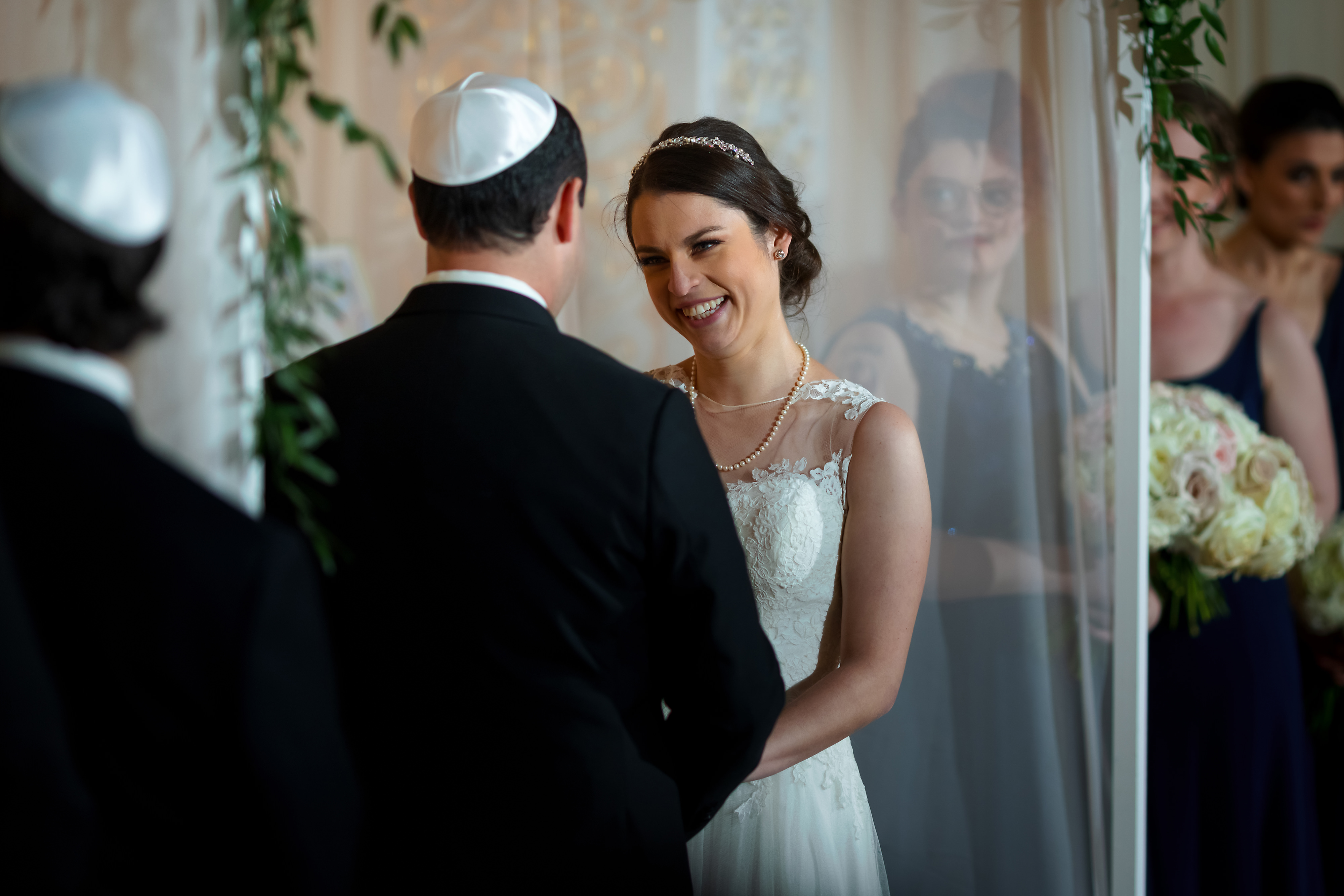 Bride smiles during wedding ceremony at the Rookery Building in Chicago