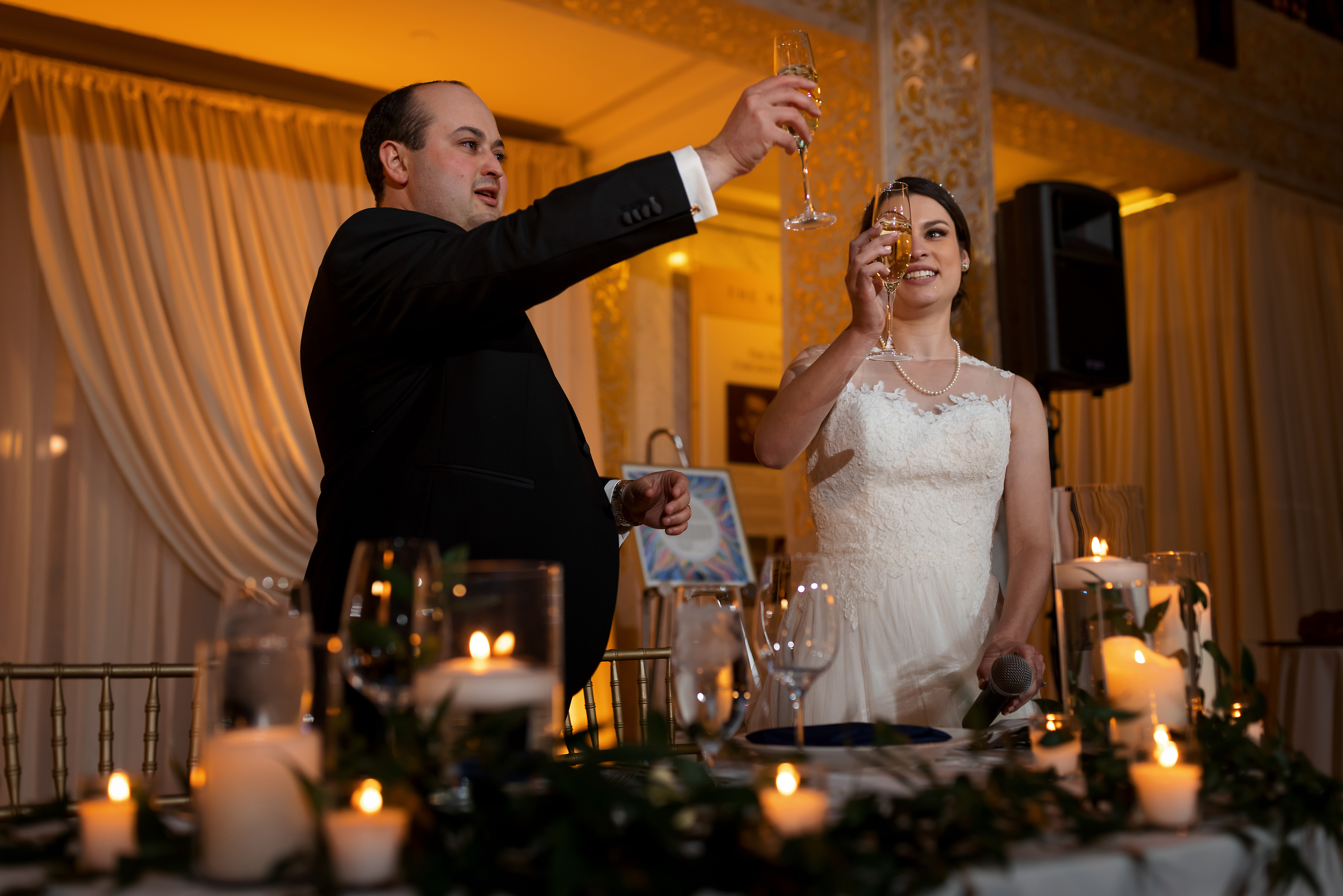 Bride and groom toast during wedding reception at the Rookery Building in Chicago
