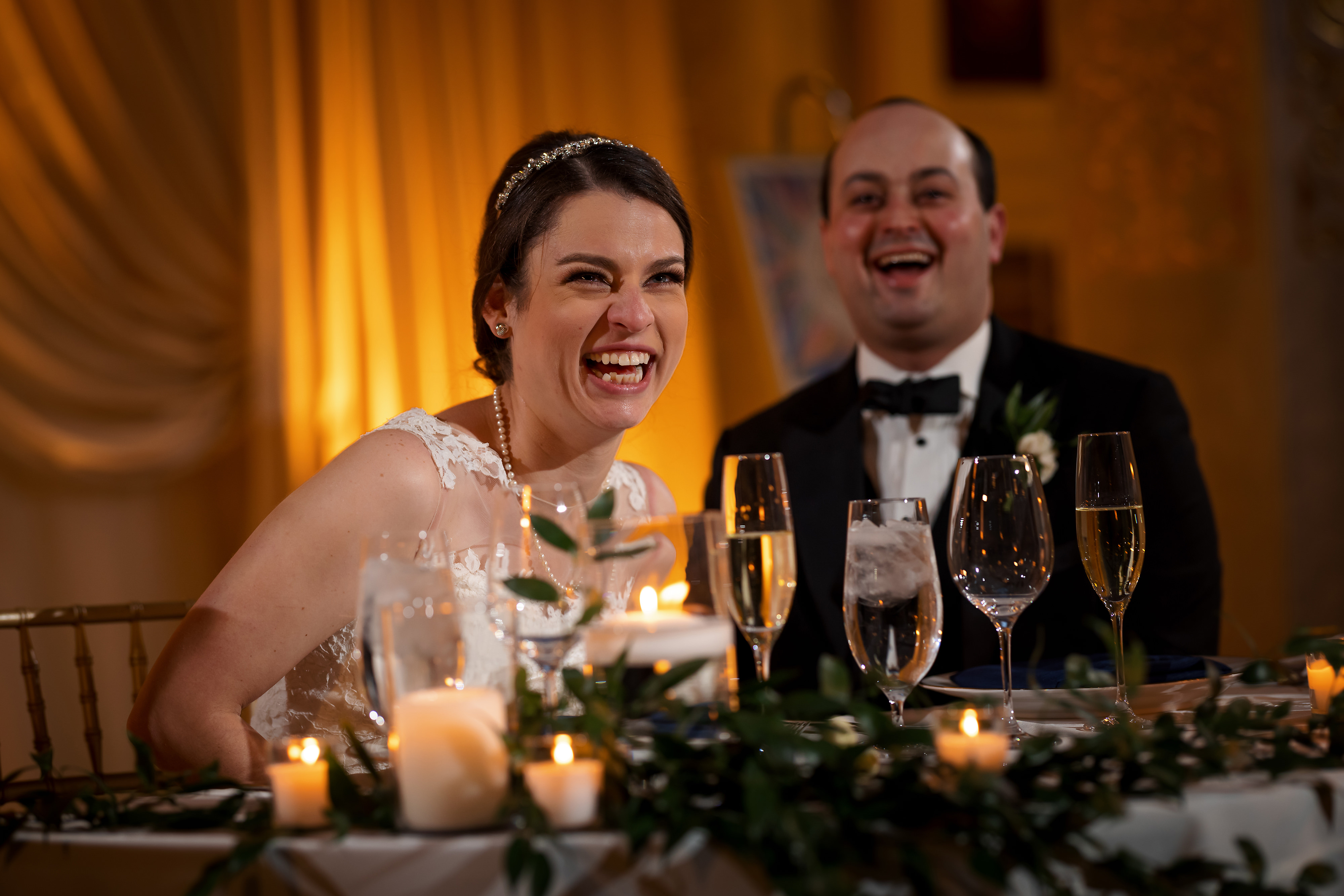 Bride and Groom laugh during toasts