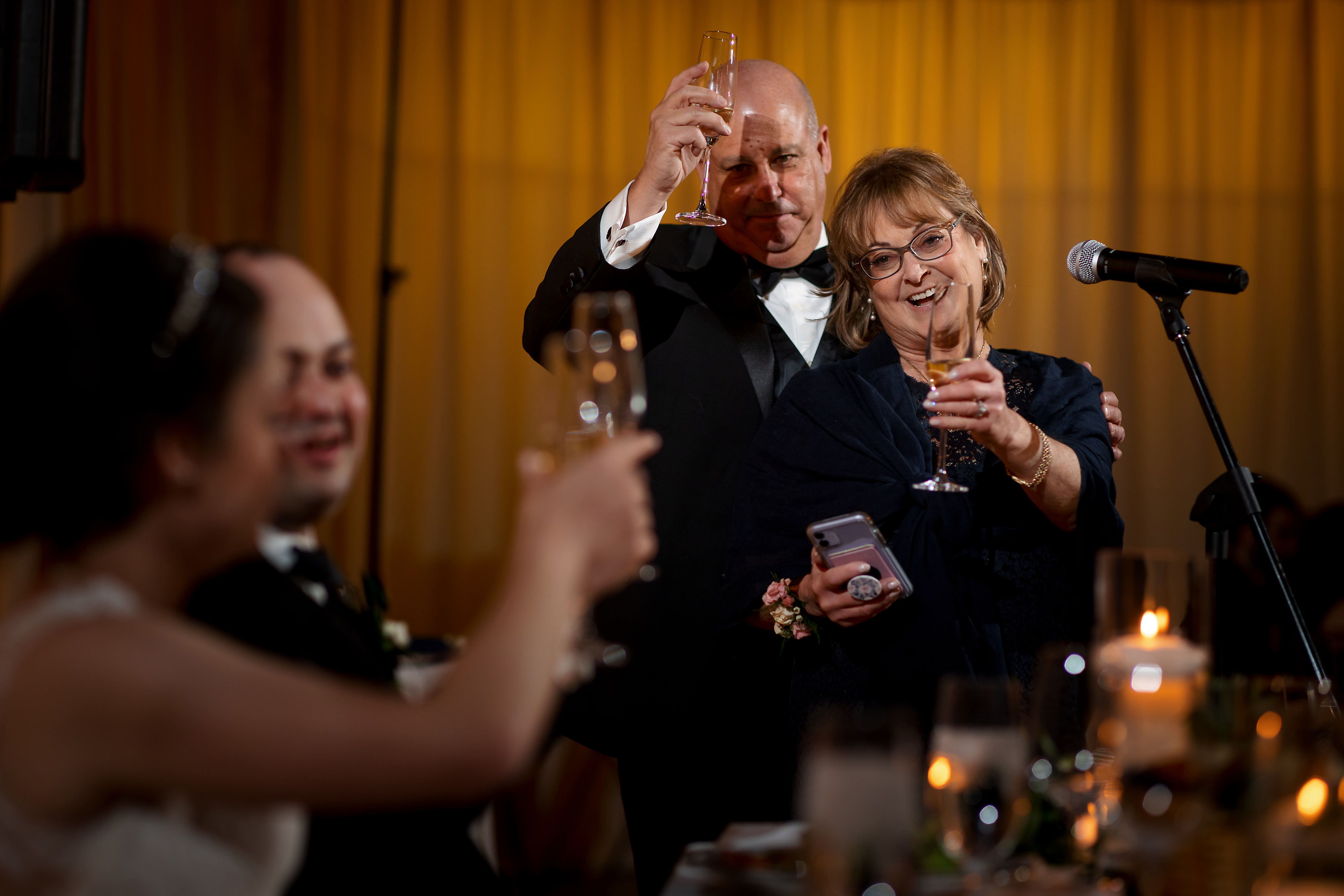 Parents of the groom give toast during wedding reception at the Rookery Building in Chicago