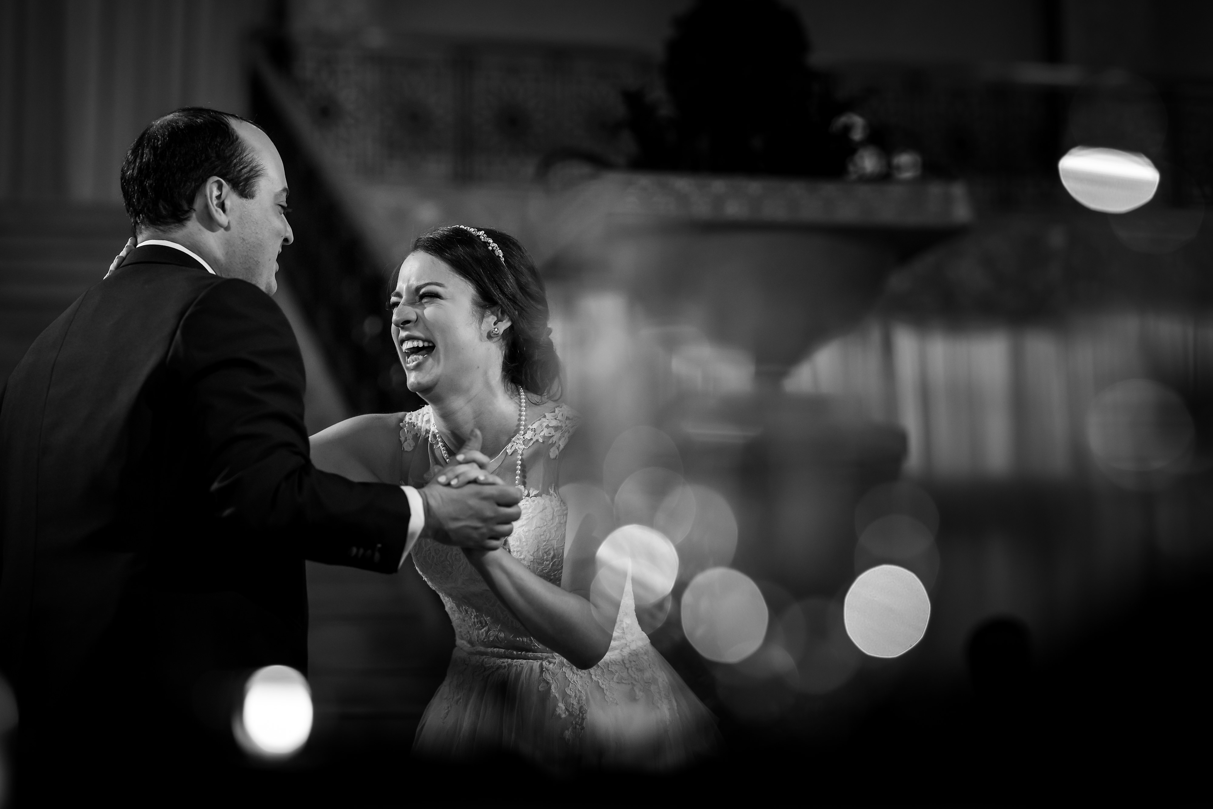 Bride and groom first dance with candles during wedding reception at the Rookery Building in Chicago