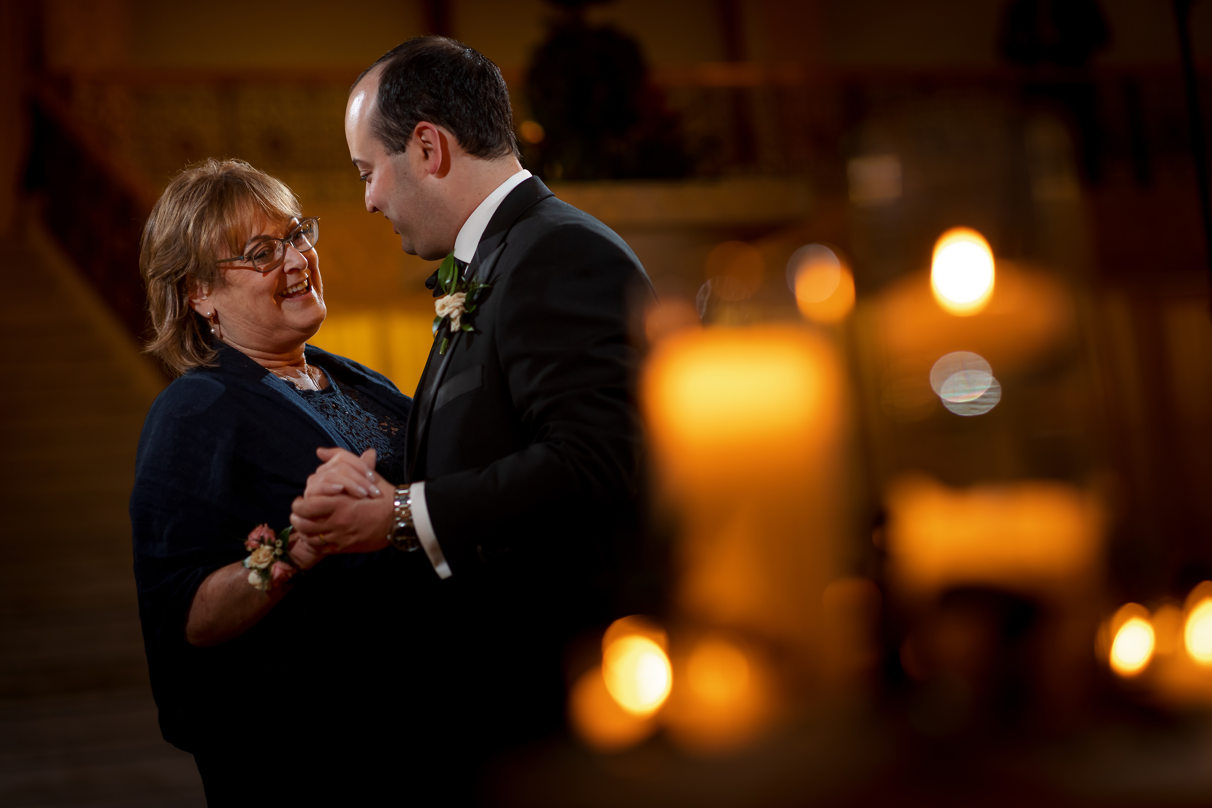 Groom dances with mother during wedding reception at the Rookery Building in Chicago