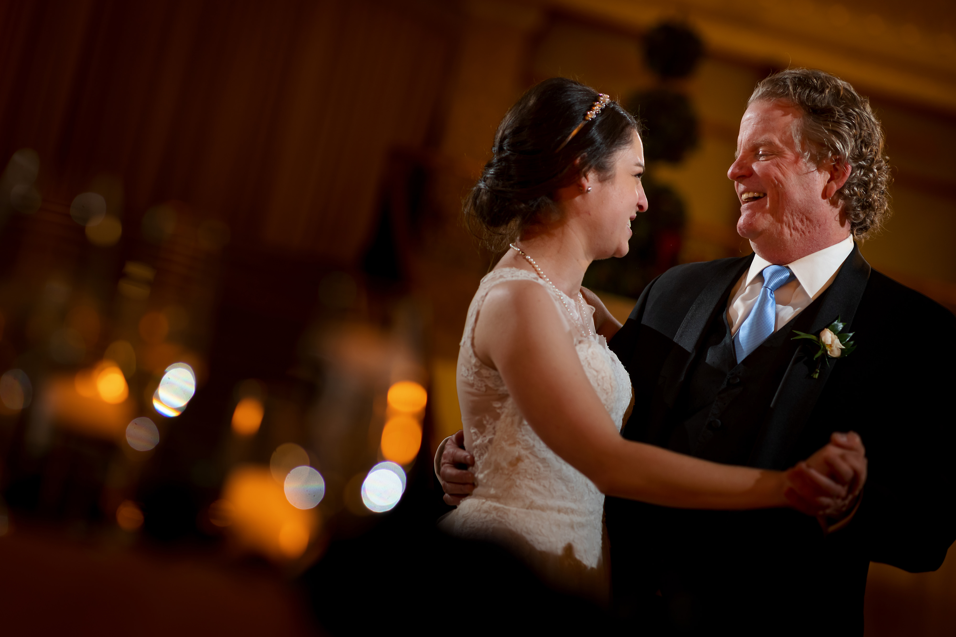 Father of the bride dances with daughter during wedding reception at the Rookery Building in Chicago