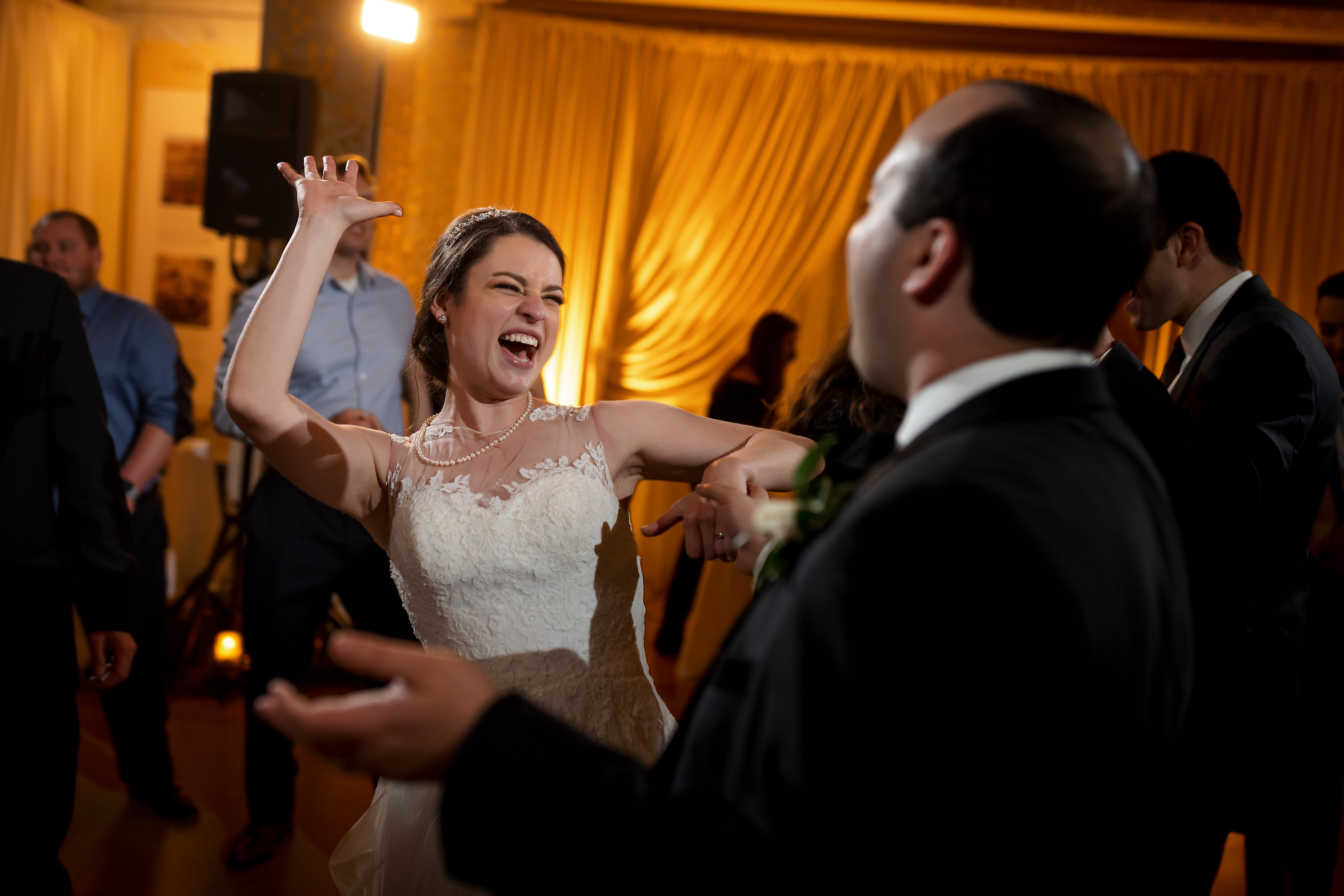 Wedding guests dance with couple during wedding reception at the Rookery Building in Chicago