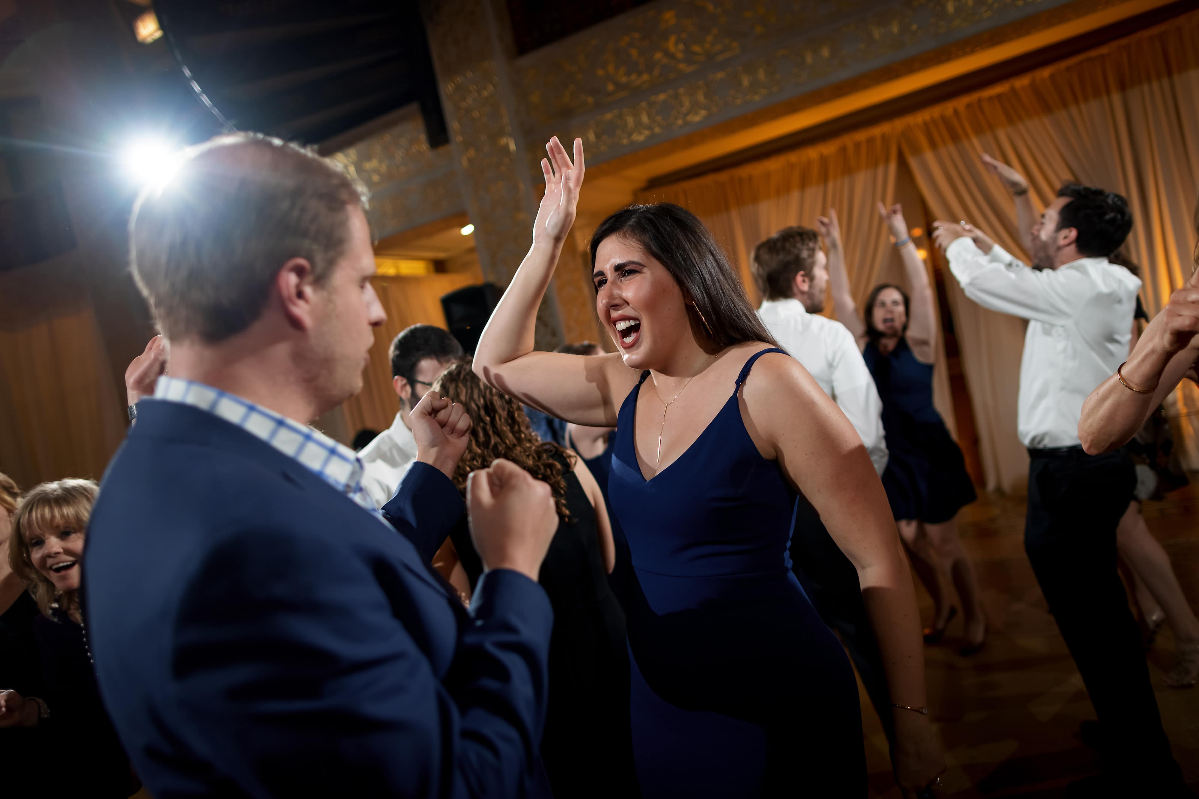 Wedding guests dance during reception at the Rookery Building in Chicago