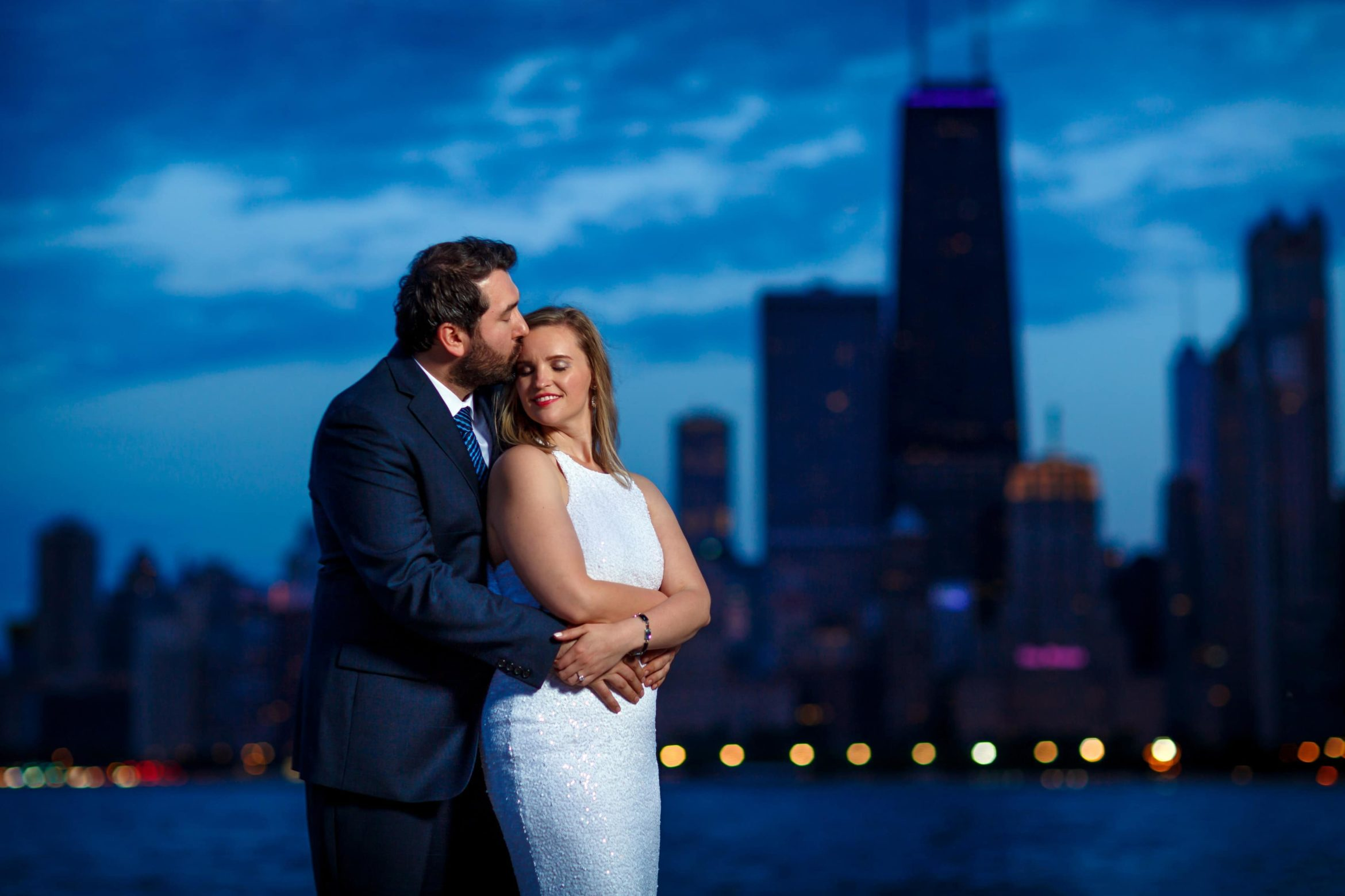 North-Avenue-beach-engagement-photos-with-a-bride-to-be-smiling-during-their-night-time-engagement-session-with-the-Chicago-skyline-in-the-background-06