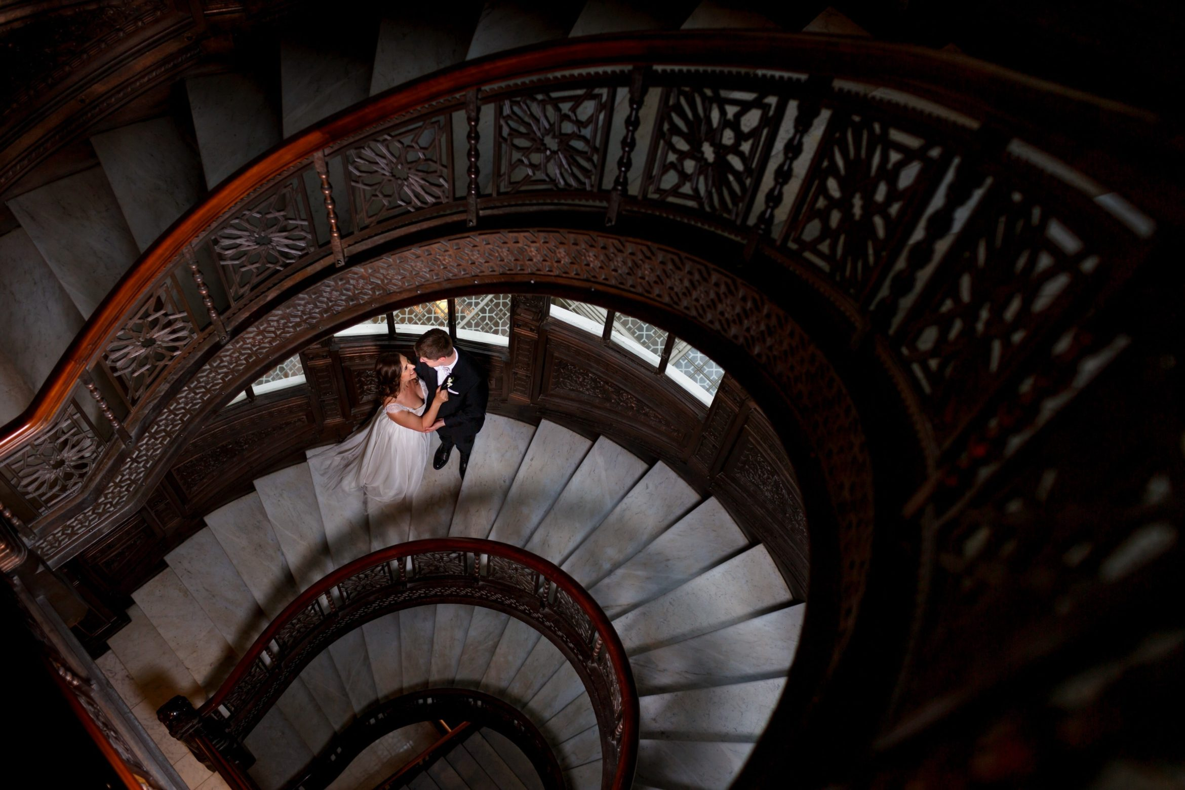 bride-and-groom-pose-for-The-Rookery-stairs-wedding-photos-before-their-wedding-ceremony-17