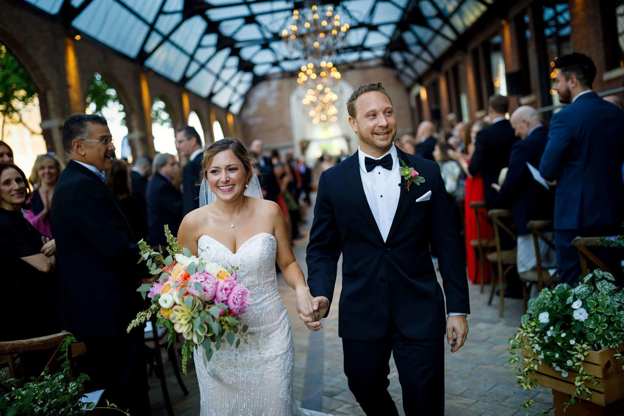 bride and groom walk back down the aisle after wedding ceremony at Bridgeport Art Center Sculpture Garden in Chicago