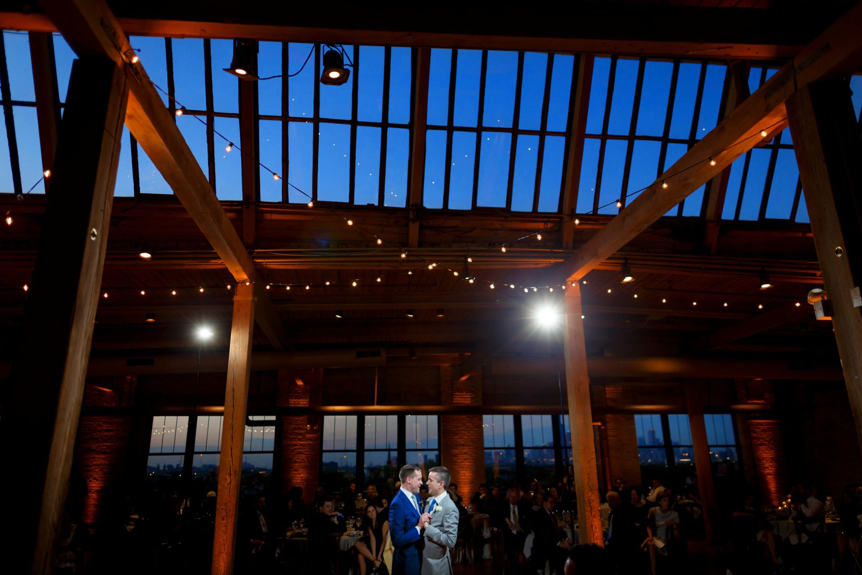 grooms-share-their-first-dance-during-their-wedding-reception-at-Bridgeport-Art-Centers-Skyline-Loft-37